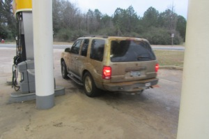 At a gas station near Waverly, we came across a car that might actually be filthier than ours.