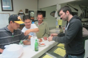 Riccardo reluctantly learns about crawfish-eating from our new friends.