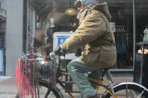 Parting shot: a typical New Orleans weirdo zooming around town on his bead-festooned bicycle.