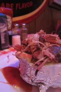 BBQ pork on a baked potato.