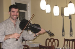 Riccardo with my cousin Dylan's viola, overcoming the hurdles of limited skill and experience.