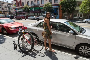 Me, our trusty vehicle, and a unicycle - in the Mission.