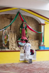 A resort employee takes a prayer break.