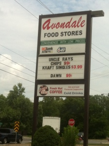 This store, advertising a special on Kraft singles, is located between two of Canada's most celebrated wineries.