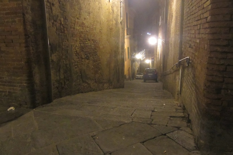 Eerie streets of Siena by night.