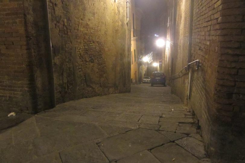 Eerie streets of Siena by night.