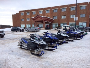 Snowmobiles in the parking lot at our hotel in Roberval.
