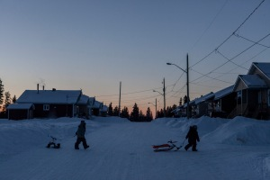 Kids coming home from a hard day's work of tobogganing.